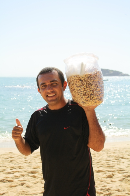 Man selling cashew nuts on the beach