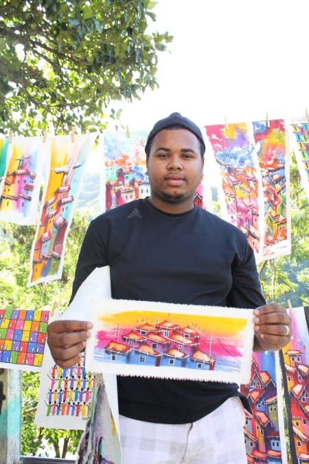 This men lives in Rocinha and found art as a happy outlet