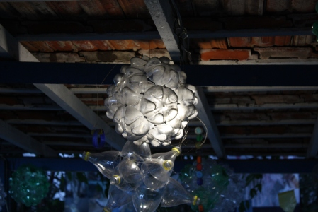 This is a chandelier made of plastic bottles, a sign of creativity—and hope.